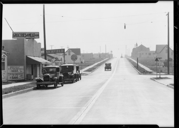 Buick and Ford at West 67th Street & South Van Ness Avenue, Los Angeles, CA, 1930