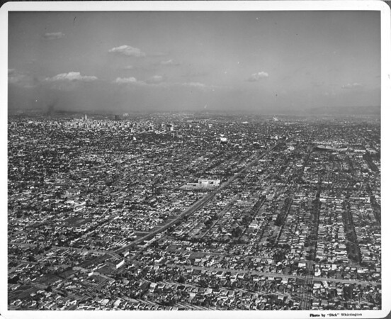Exposition Boulevard looking east, aerial view of Downtown Los Angeles