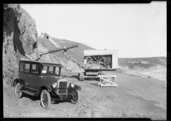Chevrolet at road along cliff, repairing damage done by high water, Santa Monica, 1926