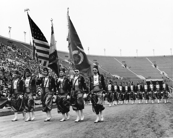 Shrine parade at Coliseum featuring Shrine contingent with banner from France