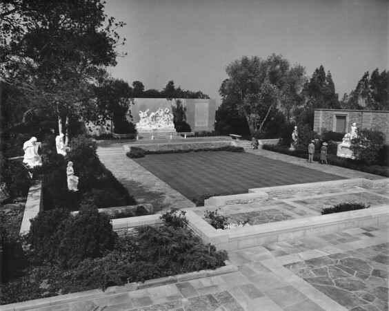 A shot of a courtyard in the Forest Lawn Memorial Park in which many sculptures