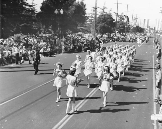 A women's marching band participating in an enormous parade