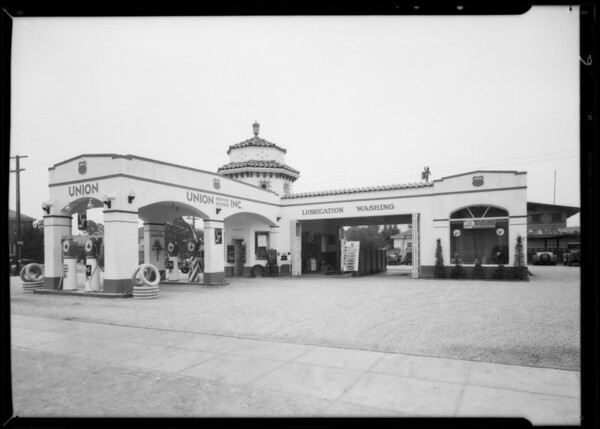 Service stations, billboard, greasy hub caps, etc., Southern California, 1932