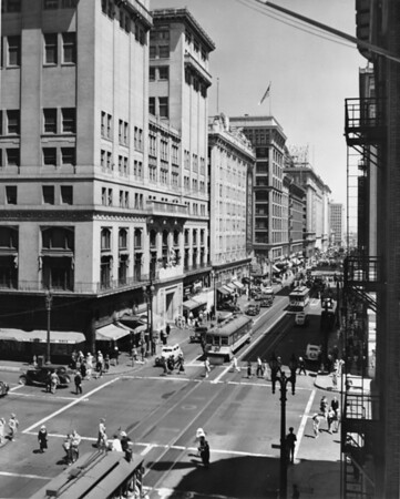 Looking east over the intersection of Seventh Street and Olive Street toward the Warner Brothers Downtown Theatre