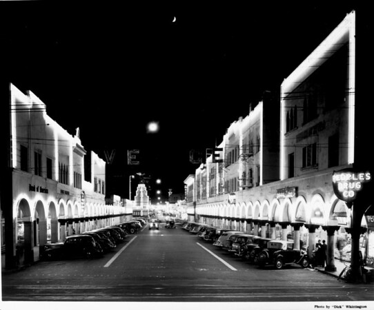 A brightly lit Venice street at night