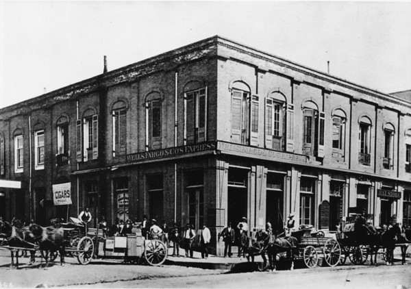 Wells Fargo & Company's Express, hat store, horse & buggy, dirt roads, cigar shop