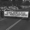 """American Legion parade, Long Beach, Colorado delegation with banner that reads: """"Colorado: $50. every Monday"""