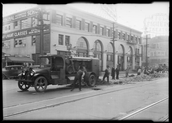 Mexican students watching men work on streetcar tracks, National Auto School, Southern California, 1931