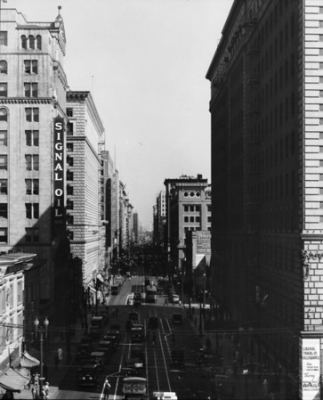 A view of Seventh Street looking east from Figueroa Street showing the Signal Oil building and the street filled with traffic