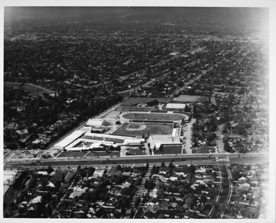 Aerial view of a race track in a residential district