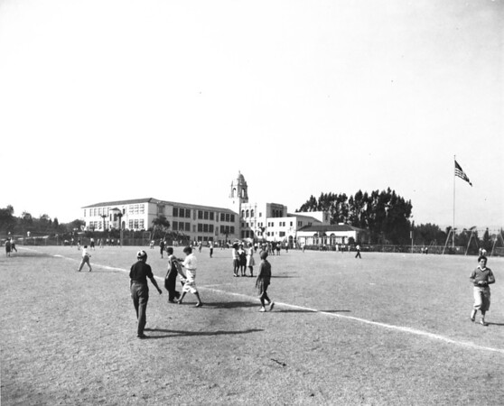 Photo of a soccer match on the school playground, looking out northwards over the city