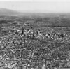 Aerial view of downtown Los Angeles and surrounding metropolitan area looking east