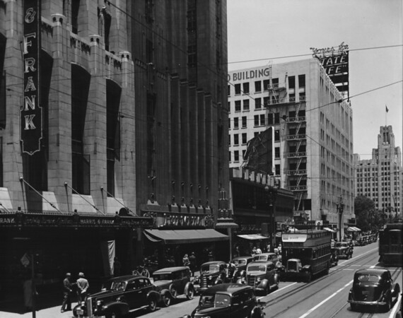 In Downtown Los Angeles facing north on South Hill Street between Sixth Street and Seventh Street, Harris & Frank, State Life, Pershing Square