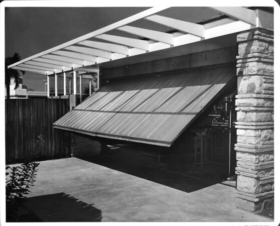 Residential home of 1948, open garage showing carpentry tools, garage style of 1948