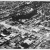 Aerial view facing northwest over the boundary between Los Angeles and Santa Monica at Wilshire Boulevard and Bundy Drive