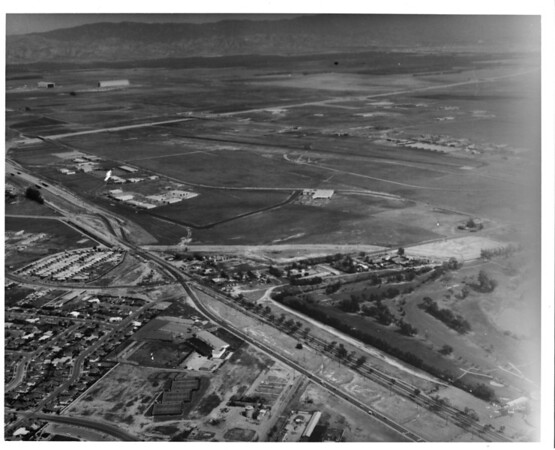 Aerial photograph showing Santa Ana Country Club, Orange County Airport and Tustin Marine Corps Air Station in Orange County, CA