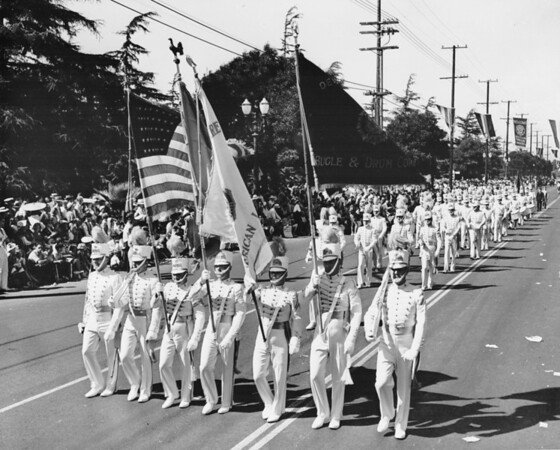 A marching band dressed in white in the American Legion Parade