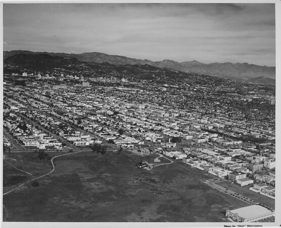 Arial view looking north over Gardner Park (Pan Pacific Park) toward the Hollywood Hills