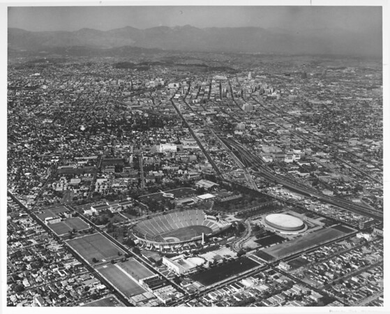 Aerial view of Los Angeles looking north from Exposition Park, Harbor Freeway, University of Southern California (USC) campus