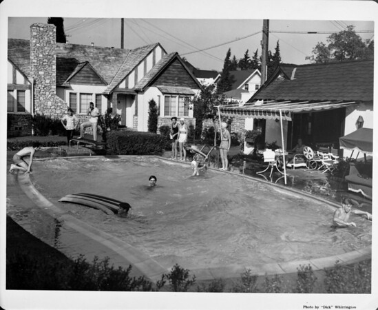Exterior of residential home in 1948 in Palm Springs, backyard, swimming pool, patio furniture
