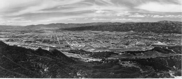A panoramic [aerial] view of the Hollywood Hills area surrounded by mountains