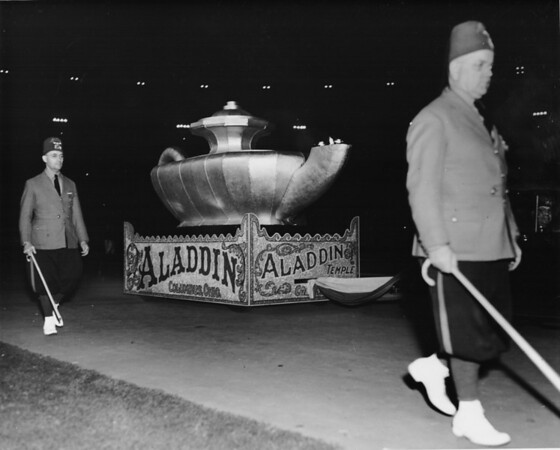 Shriner's night time parade, float representing Aladdin's lamp from the Aladdin Temple, Columbus, Ohio, accompanied by two unidentified Shriners