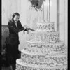 Miss Dodge cutting 2nd Anniversary cake, Orpheum Theater, Southern California, 1931