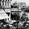 People with horses and buggies crowd the downtown streets