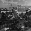 Aerial view of Wilshire Boulevard facing west from Lafayette Park past the Town House, the I. Magin tower, Simon's Sandwiches, towards the Gaylord Apartments and the Ambassador Hotel at Wilshire Boulevard and Kenmore Avenue