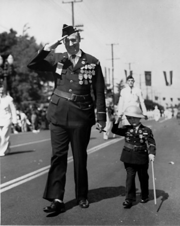 """American Legion parade, Long Beach, saluting decorated American legion """"veterans"""", young and old"""