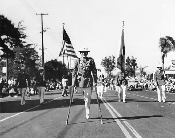 Soldiers from Alabama, led by a handicapped soldier, march in the American Legion Parade