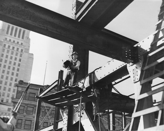 Building under construction, steelworkers, government buildings