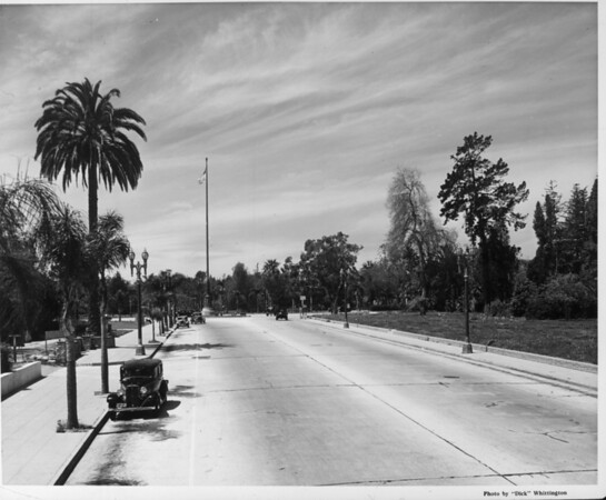 Looking down Orange Grove Avenue with an American flag waving in the distance