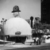 "A facade of The Brown Derby in which the sign reads ""Eat in the Hat"" on top of the restaurant"