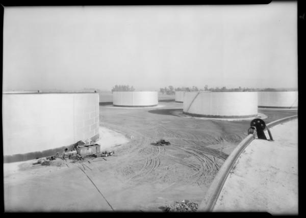 Cleaning oil storage tanks, Santa Fe Springs, CA, 1930