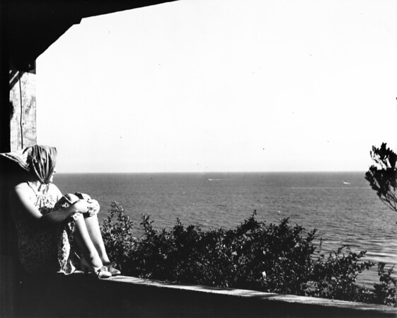 A woman looking out over the ocean