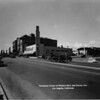 Northwest corner of Wilshire Boulevard and Norton Avenue. Thriftmart is on the corner