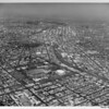 Aerial view of Exposition Park, University of Southern California (USC), Harbor Freeway (I-110), Manual Arts High School