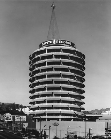 Capitol Records at the corner of Vine Street and Yucca Street, facing north towards the Hollywood Hills