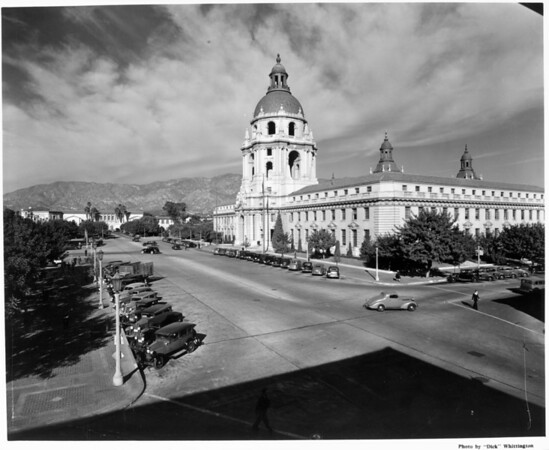 A corner view of the Pasadena City Hall with the mountains in the background