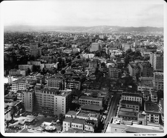 Downtown Los Angeles including the Rex Arms and surrounding buildings. Mountains in the distance