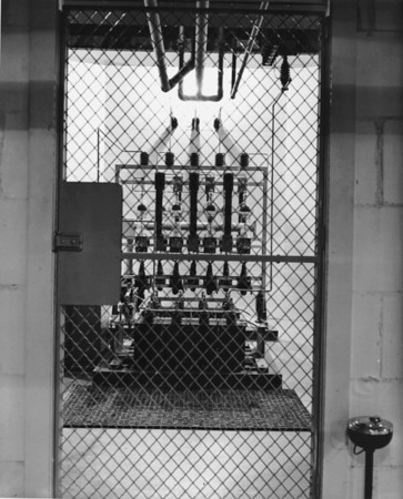 Photo of radio equipment behind a gate at a radio station