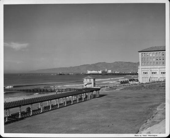 The ocean seen from Santa Monica Beach with a beach club on the right