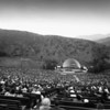 A view of a Hollywood Bowl concert from the audience, showing the parking lot behind the stage