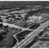 Aerial view facing north over the Veteran's Administration in West Los Angeles at Wilshire Boulevard and the San Diego Freeway (I-405)