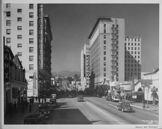 Looking down Hollywood Boulevard, the Taft Building is seen on the left side and the Hotel Plaza is seen on the right side