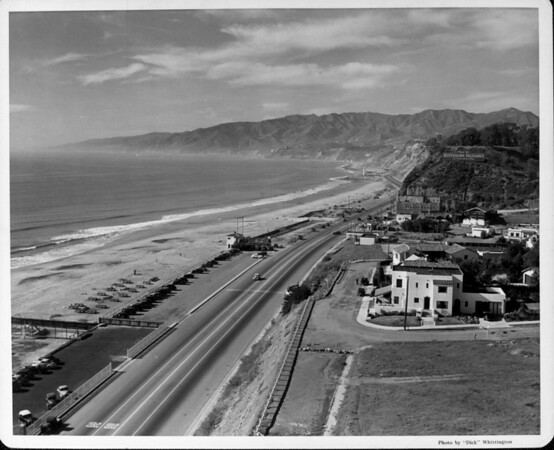 A high-angle view of the Santa Monica coast line as it stretches along the Roosevelt Highway