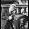 Telephone attached to motor on car, Southern California, 1929