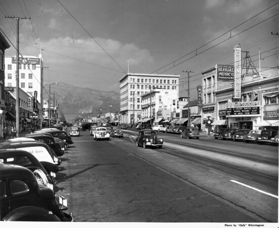 """Looking up Brand Boulevard in Glendale, CA, showing the Glendale Music Company, and the Glendale theater, which is playing """"Waikiki Wedding"""" with Bing Crosby and Martha Raye"""