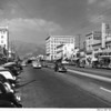 """Looking up a Glendale street, showing the Glendale Music Company, and the Glendale theater, which is playing """"Waikiki Wedding"""" with Bing Crosby and Martha Raye"""